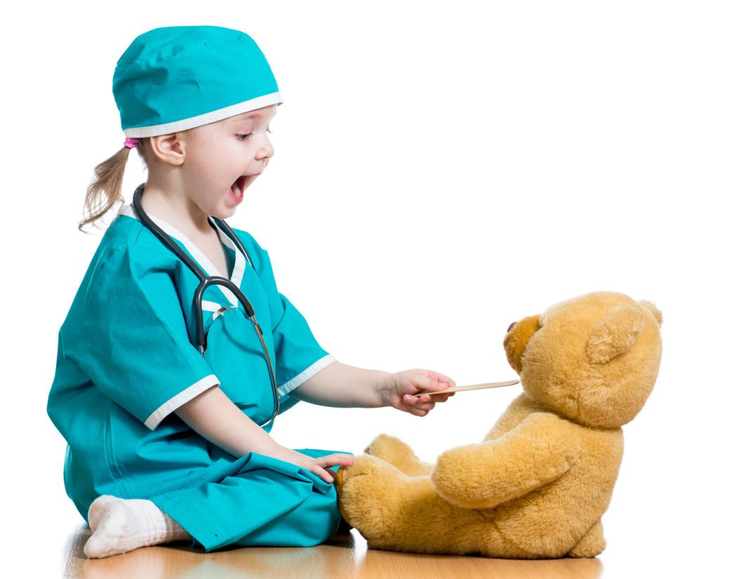 Girl Doc swabbing teddy bear